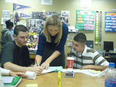 Teacher working with students